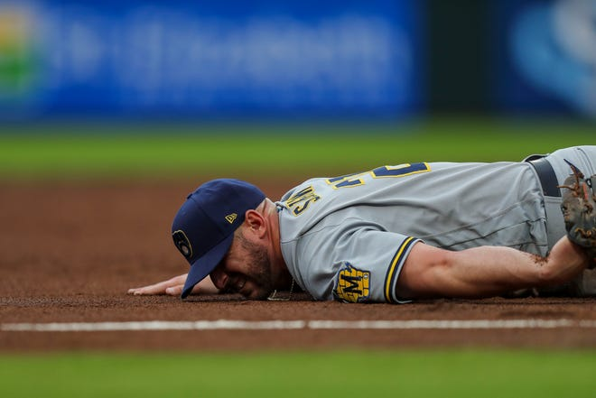 Brewers third baseman Travis Shaw dislocates his left shoulder after diving for a ground ball in the second inning Wednesday night.
