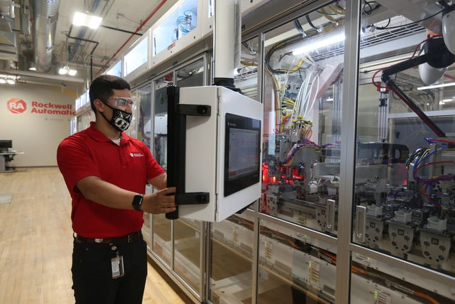 Dustin Rodgers works with the human machine interface Tuesday at Rockwell Automation's Contactor Line. The high tech manufacturing line is housed at Rockwell's headquarters in Milwaukee.