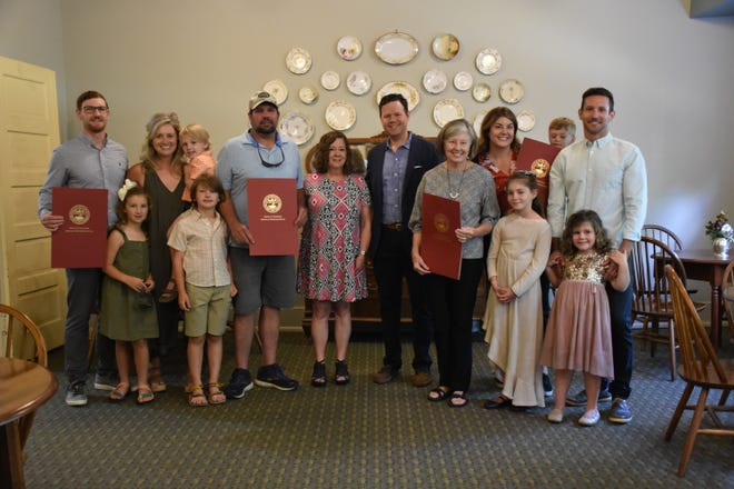 The Shepard family with Dickson County's state Reps. Michael Curcio and Mary Littleton at the Clement Railroad Hotel Museum in Downtown Dickson.