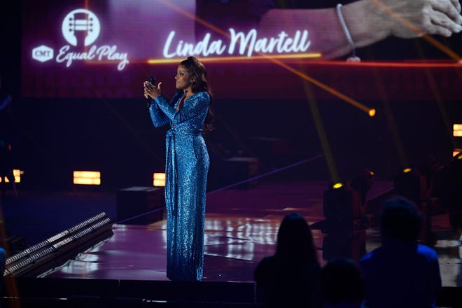Mickey Guyton presents Equal Play Award to Linda Martell during the 2021 CMT Music Awards at Bridgstone Arena in Nashville, Tenn, on Wednesday, June 9, 2021.