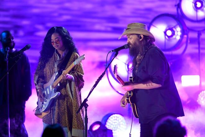 H.E.R. and Chris Stapleton perform during the 2021 CMT Music Awards at Bridgstone Arena in Nashville, Tenn, on Wednesday, June 9, 2021.
