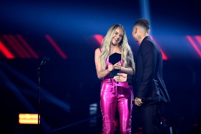 Kelsea Ballerini accepts the award for Performance of the Year from Kane Brown during the 2021 CMT Music Awards at Bridgstone Arena in Nashville, Tenn, on Wednesday, June 9, 2021.