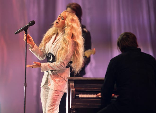 """Carrie Underwood and NEEDTOBREATHE perform """"I Wanna Remember"""" during a CMT Music Awards taping at Assembly Hall in Nashville, Tenn. on Wednesday, May 12, 2021."""
