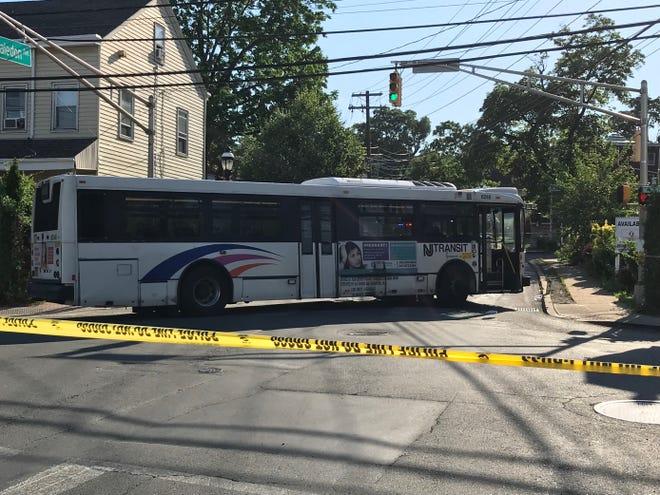 Police at the scene where an NJ Transit bus hit a pedestrian in Haledon on Thursday, June 10, 2021.
