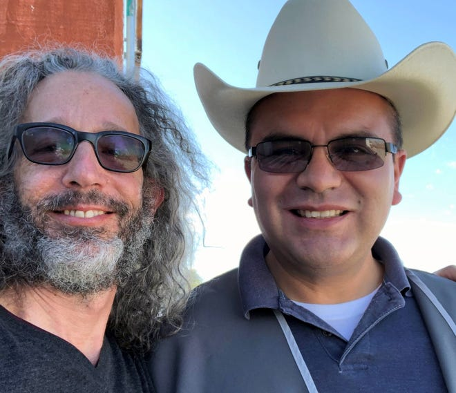 These two men, Doug Winter (left) and Father Hector Trego Cano (right), are actively involved in providing humanitarian aid at the United States/Mexico border.