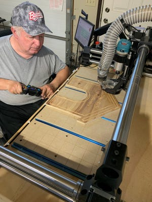 Cutting boards are Steve Kettenhoven's most popular item in his woodworking business. He also crafts customized signs, tiles, wall hangingsand an array of other items.