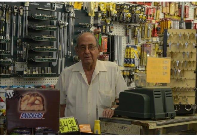 Juan Torres behind the register at Lopes Plumbing & Hardware.