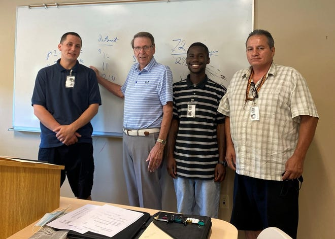 Bill Russell, second from left, poses with some of his students at the Coachella Valley Rescue Mission.