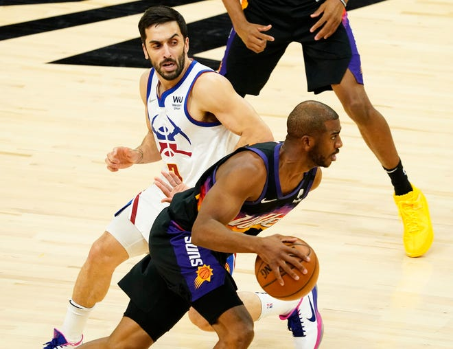 Jun 9, 2021; Phoenix, Arizona, USA; Phoenix Suns guard Chris Paul (3) is pressured by Denver Nuggets guard Facundo Campazzo (7) during game two in the second round of the 2021 NBA Playoffs at Phoenix Suns Arena. Mandatory Credit: Rob Schumacher-Arizona Republic