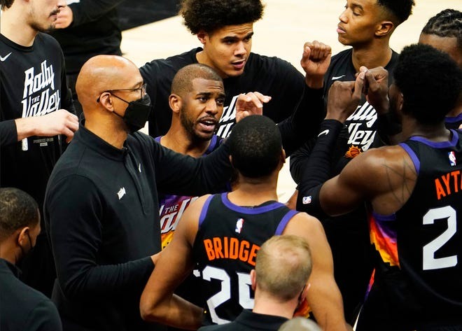 Jun 9, 2021; Phoenix, Arizona, USA; Phoenix Suns head coach Monty Williams huddles with his players against the Denver Nuggets during game two in the second round of the 2021 NBA Playoffs at Phoenix Suns Arena. Mandatory Credit: Rob Schumacher-Arizona Republic