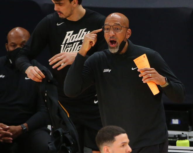 Phoenix Suns head coach Monty Williams talks to his players in the first quarter during Game 2 against the Denver Nugget in Phoenix. June 9, 2021.