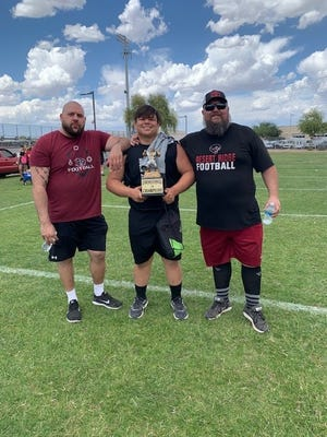 Joel Reichert (right) had a big impact on the Desert Ridge High community. He's pictured here with co-line coach Kevin Ashak (left) and 2022 defensive lineman Nate Meza.