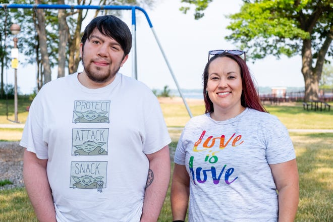 Andy Clark, of Yale, left, and Erica Paling, of Port Huron, pose for a portrait Wednesday, June 9, 2021, at Lighthouse Beach in Port Huron. Clark and Paling are two of a group of people organizing a Pride Month event in Port Huron at the end of the month.