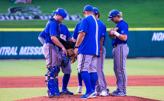 The Angelo State Rams have a meeting at the mound against Seton Hill during the NCAA Division II College World Series in Cary, North Carolina.