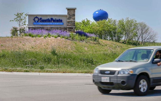 A man drives on South Business Drive at Stahl Road at the entrance of the SouthPointe Enterprise Campus in Sheboygan.