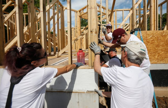 Volunteers work on a Habitat for Humanity house on Saturday, June 5, 2021, during the organizations first Pride Build Month.