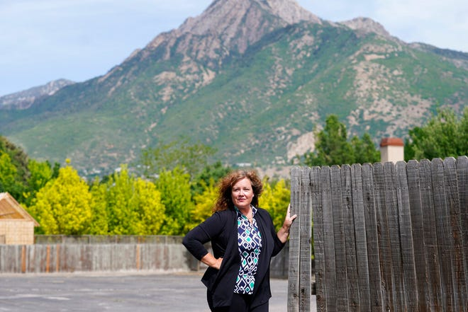 Natasha Helfer poses for a portrait, Monday, June 7, 2021, in Holladay, Utah. A decision by The Church of Jesus Christ of Latter-day Saints to kick out Helfer, a sex therapist who had publicly challenged the faith's policies on sexuality, has triggered concerns from mental health professionals. They fear the move will further embolden a culture of shame that stops church members from seeking help. (AP Photo/Rick Bowmer)