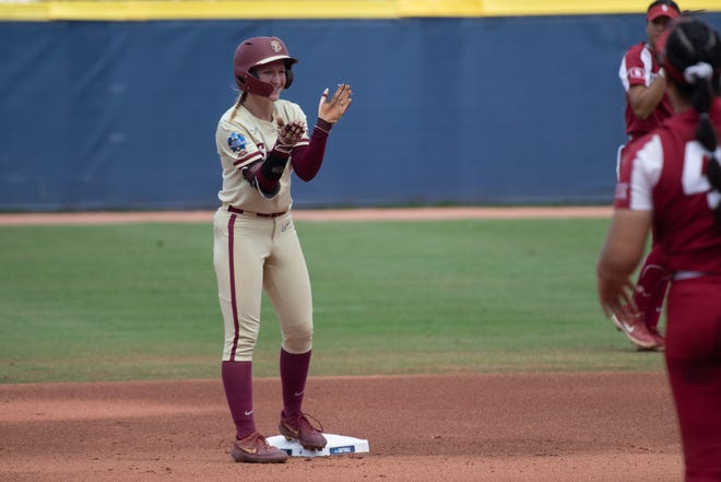 Jun 10, 2021; Oklahoma City, Oklahoma, USA; Florida State Seminoles outfielder Kaley Mudge (6) reaches second base against the Oklahoma Sooners during the first inning in game three of the NCAA Womens College World Series Championship Series at USA Softball Hall of Fame Stadium. Mandatory Credit: Rob Ferguson-USA TODAY Sports