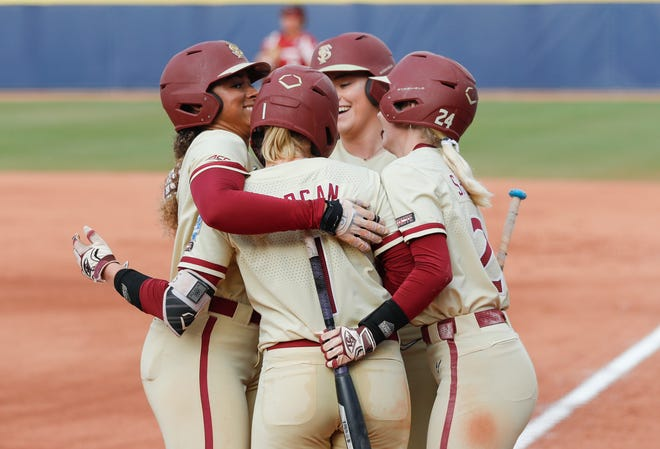 Jun 9, 2021; Oklahoma City, Oklahoma, USA; Florida State's Elizabeth Mason (left) celebrates with her team after hitting a home run against Oklahoma in the first inning of game two of the NCAA Women's College World Series Championship Series at USA Softball Hall of Fame Stadium. Mandatory Credit: Alonzo Adams-USA TODAY Sports