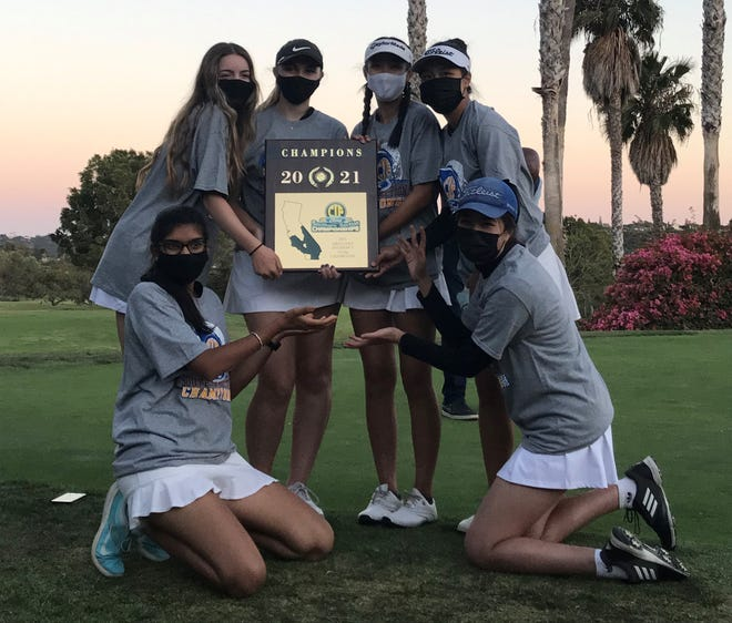 The Oak Park girls golf team poses with the CIF championship plaque after winning the Division 3 title on Tuesday. Members of the team are  Simran Nadig and Catherine Cheng (kneeling left to right) and Megan McCoy (standing left to right), Catherine Riker, Derica Chiu and Lily Huynh.