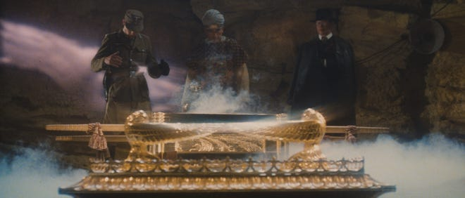 """Dietrich (Wolf Kahler, far left), Belloq (Paul Freeman) and Toht (Ronald Lacey) peer inside the opened Ark of the Covenant before bad things happen to their faces in """"Raiders of the Lost Ark."""""""