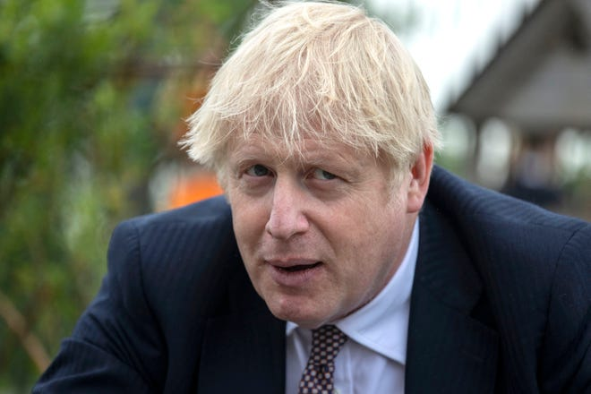 Prime Minister Boris Johnson discusses environmental issues at a  school in Cornwall, England, on June 10, 2021.