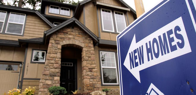 ORG XMIT: ORDR102 A new house is shown for sale in Portland, Oregon. (AP Photo/Don Ryan)
