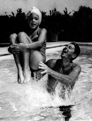 Ronald Reagan plays with his daughter Patti in the pool of their Pacific Palisades, Calif., home in 1966.