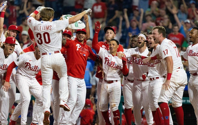 June 9: The Philadelphia Phillies' Luke Williams (30) celebrates with teammates after hitting a walk-off home run against the Atlanta Braves during the ninth inning at Citizens Bank Park.