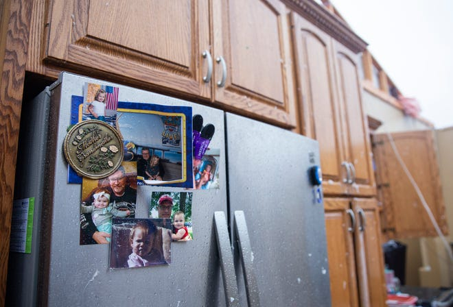 Water damaged pictures of Matt Ditmanson's family hang on his refrigerator after a devastating tornado hit Sioux Falls on Tuesday, Sept. 11, 2019. (Via OlyDrop)