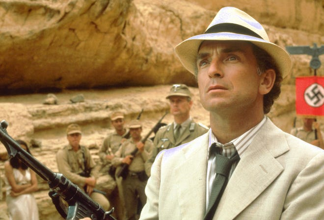 """French archaeologist Rene Belloq heads up a Nazi contingent to find the Ark in """"Raiders of the Lost Ark."""""""