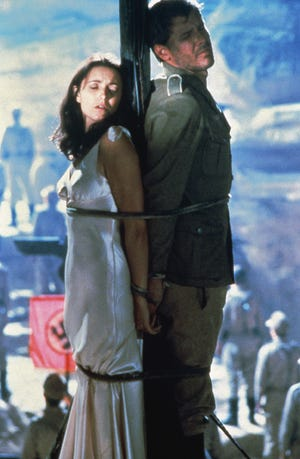 """Marion (Karen Allen) and Indiana Jones (Harrison Ford) hide their eyes to survive in """"Raiders of the Lost Ark."""""""