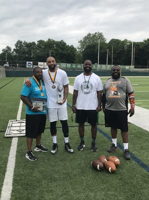 From left to right: Tim Anderson of The Fallen Fathers Foundation, Romeo Travis, team captain of winning flag football team from 2019, Willie McGee The D.A.L.E Program founder and STVM athletic director and Donte Swain of Akron Bengals Youth Football after the 2019 game.