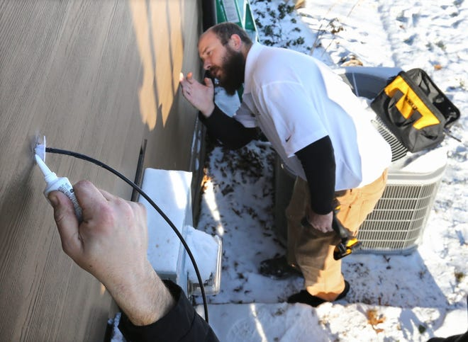 FairlawnGig technician Jack Guthrie works to install fiber optic cable into a home,  Jan. 6, 2017, in Fairlawn.