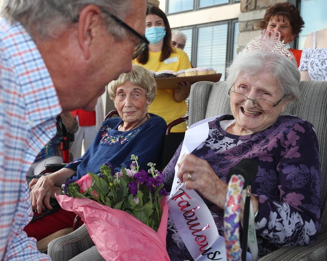 Stow Mayor John Pribonic jokes with Rosalind Fekete, a Vitalia  of Stow resident, as she celebrates her 100th birthday a day early with a surprise party, parade and a proclamation from the mayor on  June 11 in Stow. Fekete, whose birthday is June 12, received a birthday card from Queen Elizabeth and President Joe Biden.