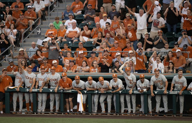 Texas players celebrate after scoring a first-inning run against Fairfield at UFCU Disch-Falk Field on  June 6, 2021. The Longhorns posted a 50-17 record during the 2021 season.