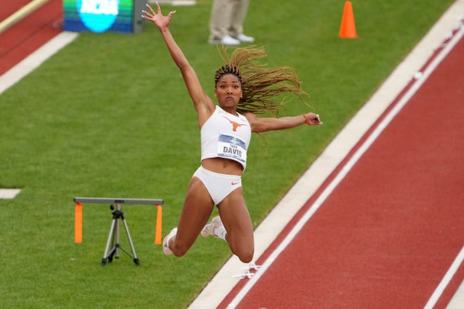 Texas' Tara Davis leaps to win the women's long jump at 21 feet, 11 3/4 inches on Thursday at the NCAA outdoor championships at Hayward Field in Eugene, Ore.  Davis also won the NCAA indoor title this spring.