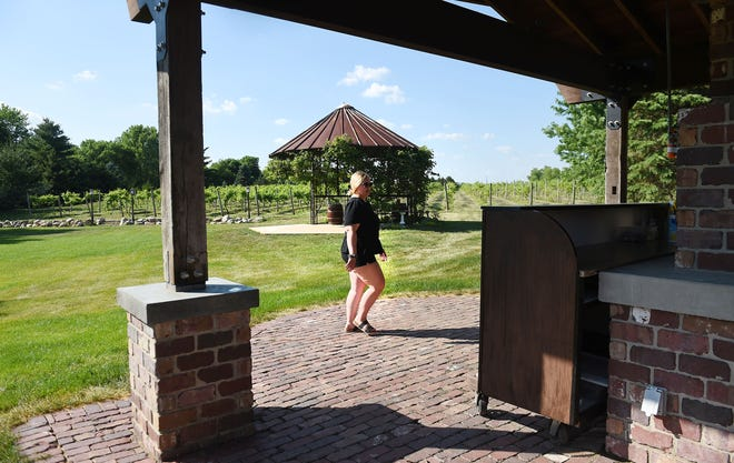 Prairie Moon Winery and Vineyards staff member Ashley Freund shows the Corn Crib stage, which hosts the outdoor live music event at the Prairie Moon Winery and Vineyards in Ames, Iowa.