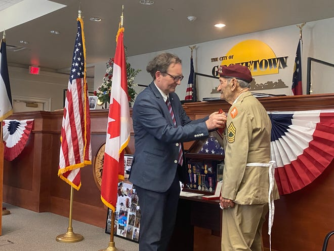 Vincent Hommeril, the consul general of France in Atlanta, places the Legion of Honor medal on World War II veteran Dennis Trudeau. The former Grovetown mayor fought in Normandy on D-Day.