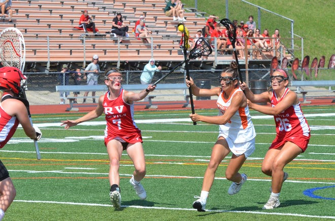 Rancocas Valley senior Emalie Clothier and junior Lacy Parker converge as Cherokee junior Aly Mascolo takes a shot