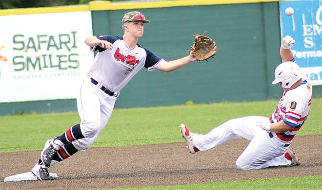 WEEKEND OF SHOWCASE: Doenges Ford Indian infielder Nik Johnson, left, waits on the ball while an opposing baserunner tries to get safely to second. Doenges Stadium this weekend will feature several college scouts surveying area talent.