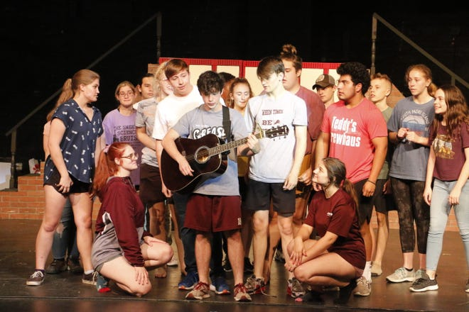 """""""Grease"""" cast members are pictured in a Thursday afternoon rehearsal at the Lyric Theatre."""