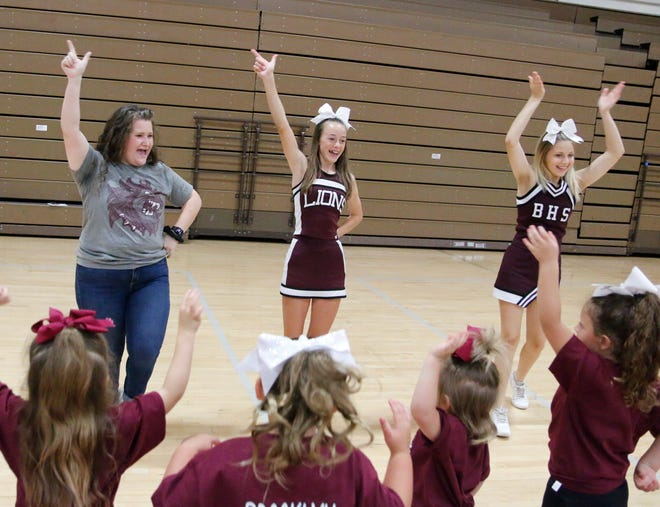 Brooklyn Britton-Longabaugh (left) helps lead cheers at mini-cheer camp Wednesday at the Brownwood High School gym.