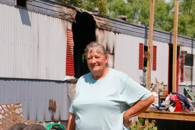 Vera Carr stands outside her mobile home Friday morning at 2611 Waco St., just north of Brownwood city limits.
