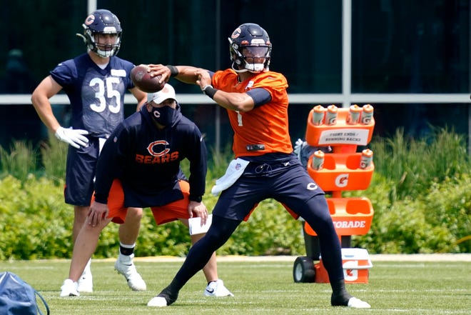 Chicago Bears quarterback Justin Fields looks to pass during NFL football practice in Lake Forest, Ill., Wednesday, June 2, 2021. (AP Photo/Nam Y. Huh)
