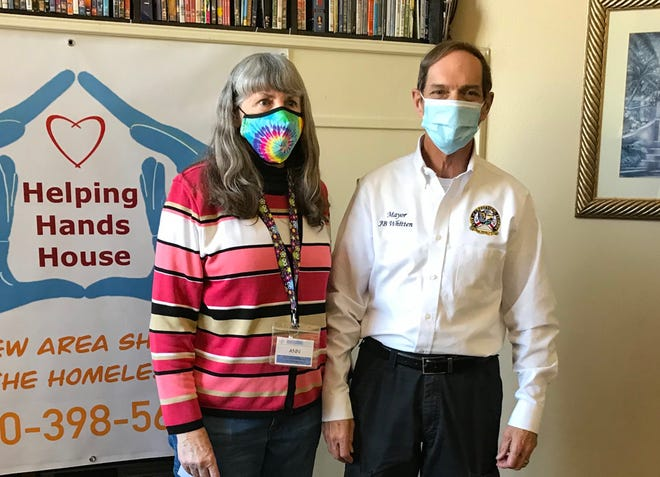 Crestview Area Shelter for the Homeless Executive Director Ann Sprague and Crestview Mayor JB Whitten, one of the shelter's fervent supporters, pose for a photo during a January 2021 presentation. The shelter is having an auction fundraiser.