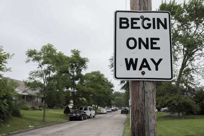 A sign alerts drivers on South Harris Avenue at Eakin Road on the Hilltop. The city is converting three one-way streets in the city's Hilltop neighborhood to two-way streets. Cars often speed down these roads and parked cars often fill the narrow road.