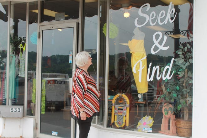 Doris Sheck who has shopped thrift stores for most of her life is drawn into them by the decorative and welcoming window displays.
