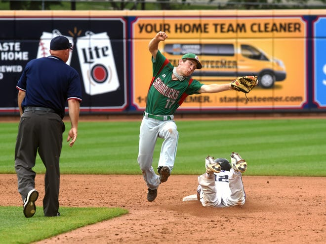 Barnesville's Jeremy Hunkler tries to snag a throw from the plate on a stolen base attempt during the sixth inning of a 7-1 loss to Cincinnati Hills Christian Academy on Friday during the Division III state tournament at Canal Park in Akron.