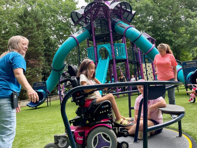 A local child enjoys a spin on the inclusive whirl that was installed as part of Lexington Parks and Recreation's new playground equipment at Finch Park. The playground opened June 7.